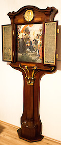 A German Art Nouveau gilt bronze and brass mounted rosewood commemorative tryptic Berlin, signed and dated 1901, the cabinet by Alfred Grenander (1863 – 1931), the painting by Arthur Kampf (1864 – 1950) and the metalwork by Otto Rohloff (1863 – 1919)
